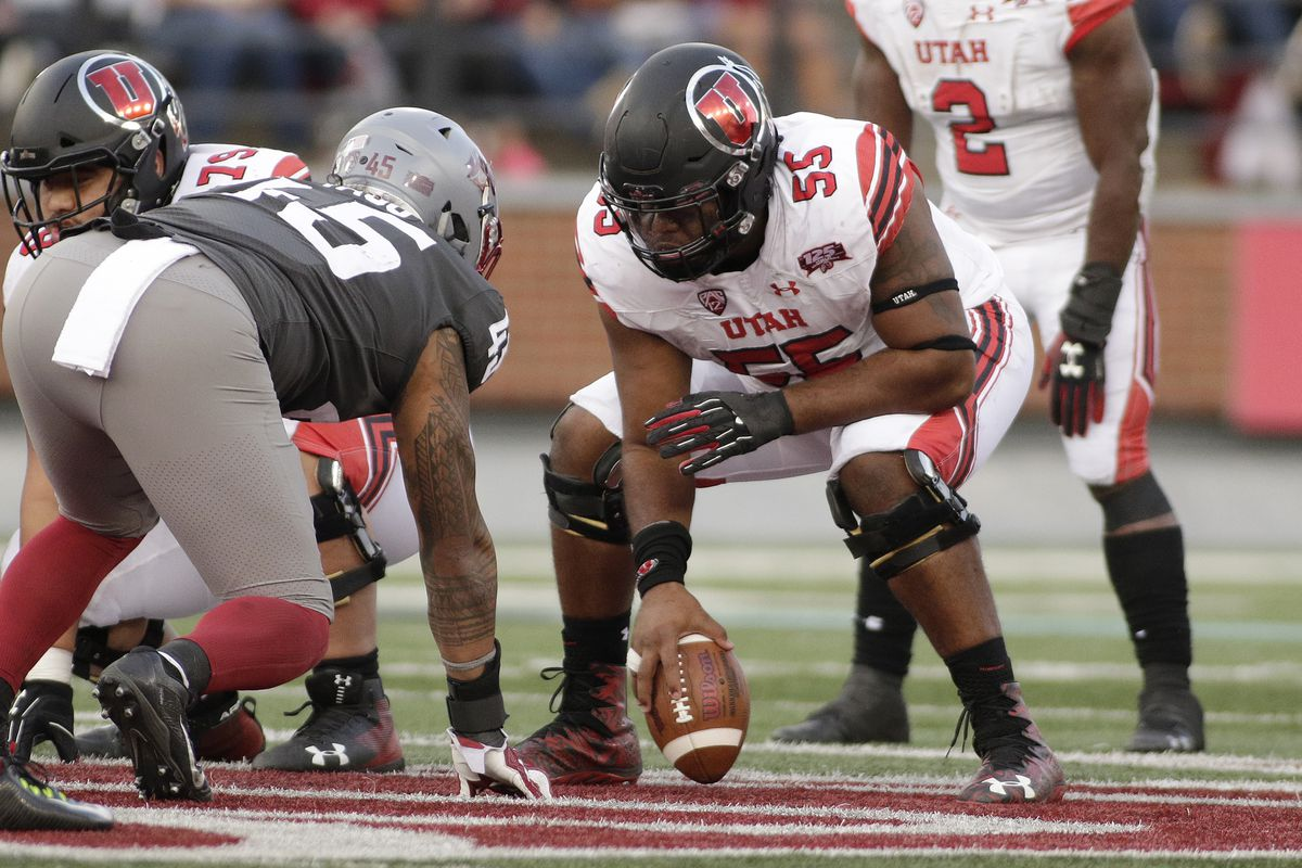 Utah Utes center Nick Ford prepares to snap the ball.