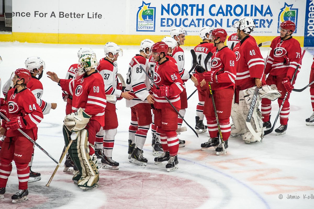 The handshake line after the red/white scrimmage on Saturday