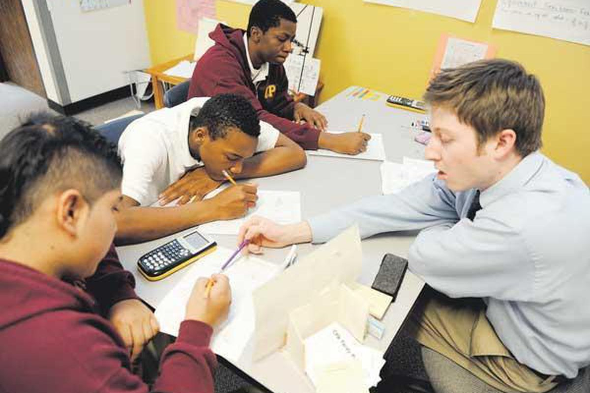 Collegiate Prep Academy ninth-graders work with a math tutor in 2012.