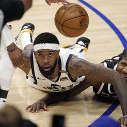 Utah Jazz forward Royce O'Neale, left, and Los Angeles Clippers guard Paul George go after a loose ball during the second half in Game 6 of a second-round NBA basketball playoff series Friday, June 18, 2021, in Los Angeles.
