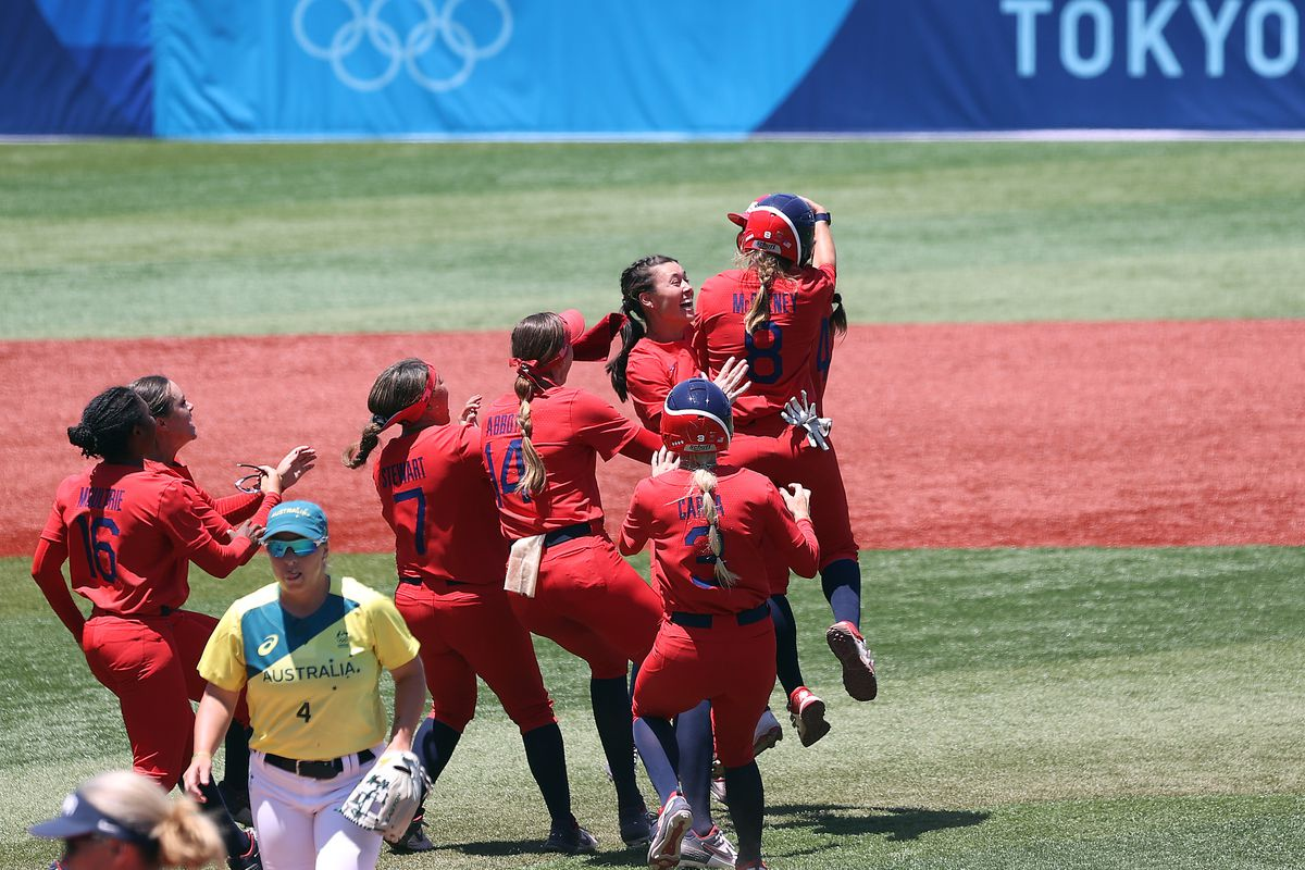Haylie McCleney, Janette Reed, Monica Abbott, Kelsey Stewart and Michelle Moultrie of Team United States celebrate with Amanda Chidester after Chidester hit a two-run RBI single in the eighth inning to win the game 2-1 as Stacey Mcmanus of Team Australia looks on after their game during the Softball Opening Round on day two of the Tokyo 2020 Olympic Games at Yokohama Baseball Stadium on July 25, 2021 in Yokohama, Kanagawa, Japan.