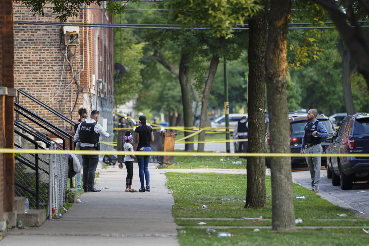 Police investigate the scene near Christiana and Douglas Boulevard in Lawndale, Wednesday, July 21, 2021.