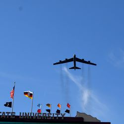 A B-52 bomber cruises low over Doak for Military Day.