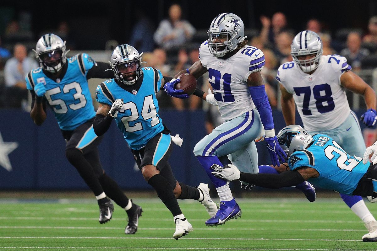 Ezekiel Elliott #21 of the Dallas Cowboys runs the ball against the Panthers at AT&T Stadium on October 03, 2021 in Arlington, Texas.