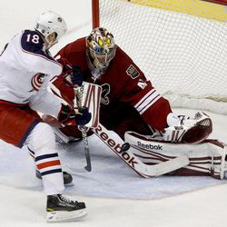 Phoenix Coyotes' Mike Smith, right, makes a save on a shot by Columbus Blue Jackets' R.J. Umberger (18) during the second period in an NHL hockey game Tuesday, April 3, 2012, in Glendale, Ariz.