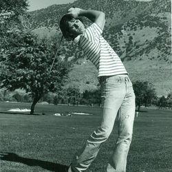 Utah State golfer Jay Don Blake follows through on a shot.