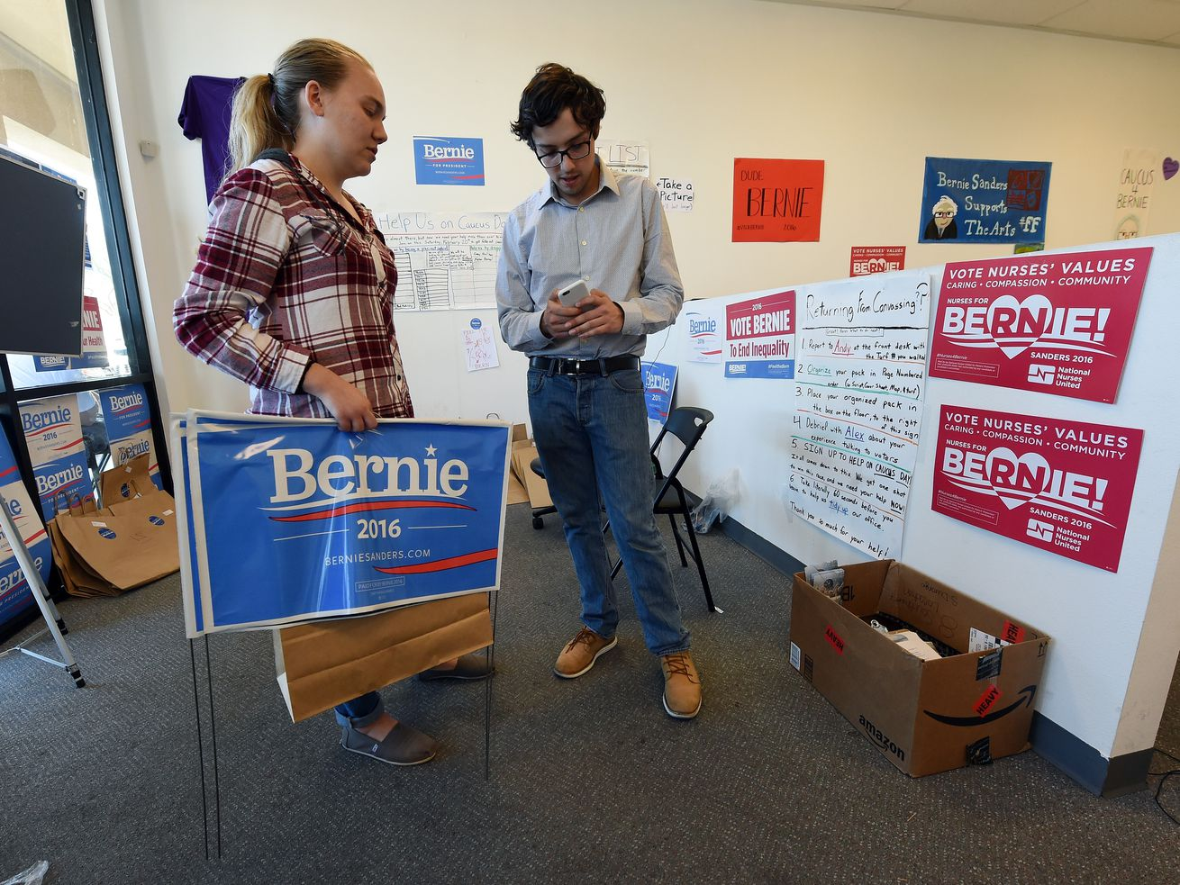 Precinct captain Allison Balden gets materials from field organizer Jonathan Mason at a campaign office for Bernie Sanders on February 19, 2016, in Henderson, Nevada.