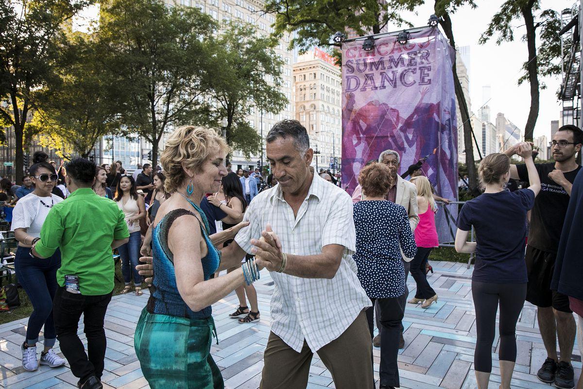 Hundreds dance salsa as Orquesta El Macabeo performs during Chicago SummerDance, part of Taste of Chicago in Grant Park's Spirit of Music Garden on Saturday night, July 8, 2017. | Ashlee Rezin/Sun-Times