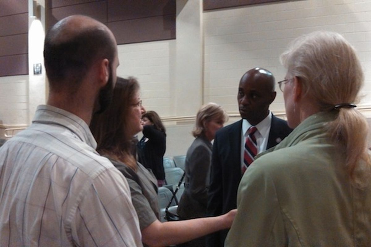 SCS Supt. Dorsey Hopson II talks with world language teachers after Thursday night's community budget forum at Whitehaven High School,