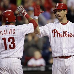 Philadelphia Phillies' Freddy Galvis, left, and Cliff Lee celebrate after Galvis' home run in the third inning of a baseball game against the New York Mets, Friday, April 13, 2012, in Philadelphia.