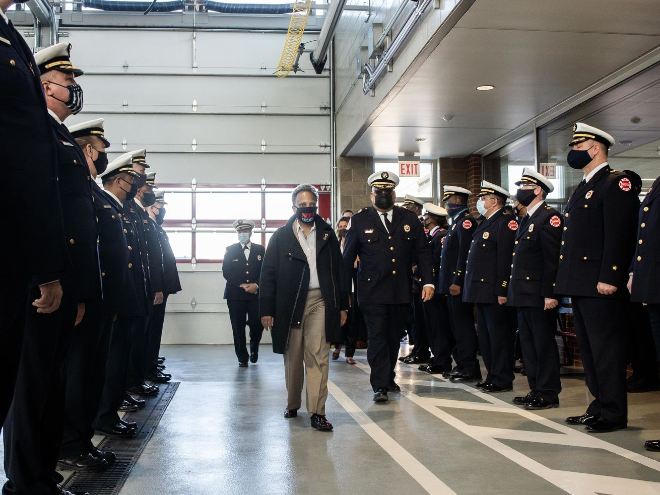 Mayor Lori Lightfoot, surrounded by members of the Chicago Fire Department, walks to a press conference and ribbon cutting ceremony for Engine Company 115's new firehouse at 1024 W. 119th St. in the West Pullman neighborhood, Wednesday morning, March 31, 2021.