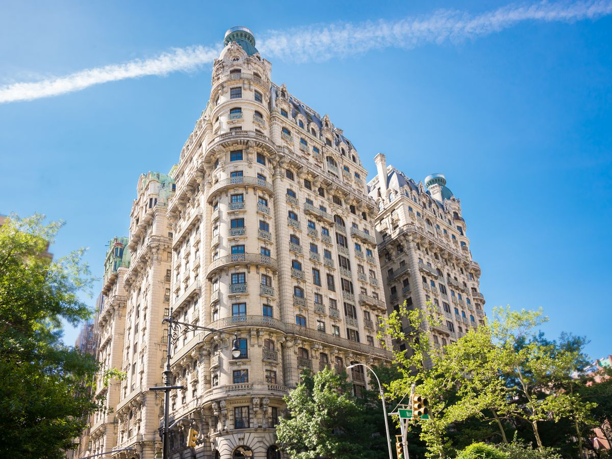 The exterior of the Ansonia in New York City. The facade is ivory with metal ornamentation.