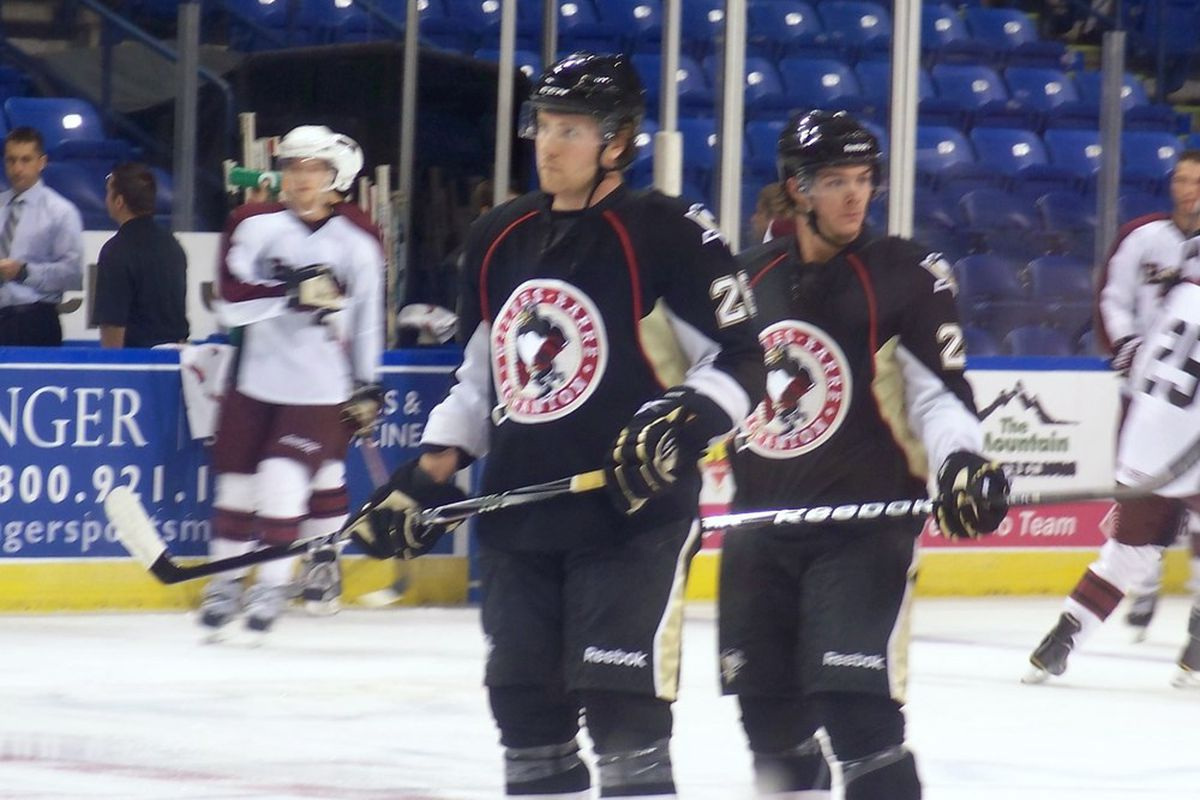 Geoff Walker, left, benefited in his first game on the team's top line with the game winning goal and an assist on the Pens first goal tonight.