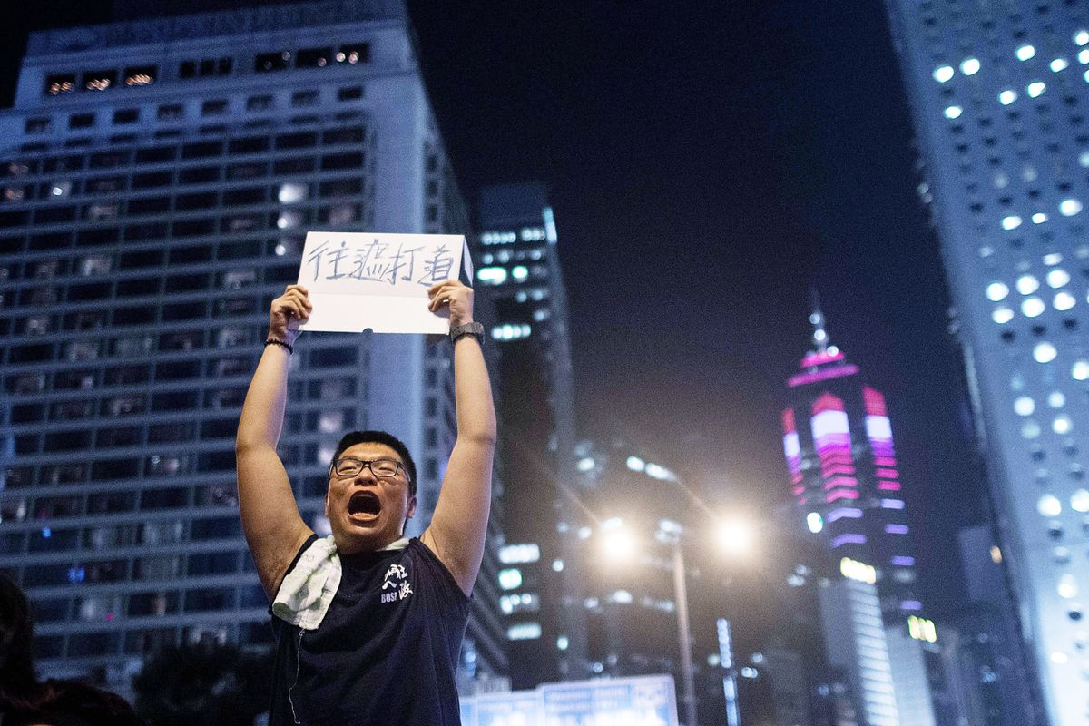 A protestor directs crowd movements during a Hong Kong protest.