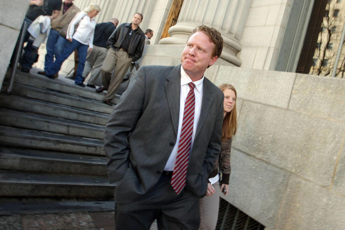 Federally-indicted businessman Jeremy Johnson walks from the federal courthouse following a hearing March 12, 2013, in Salt Lake City. U.S. District Magistrate Judge Paul Warner threatened to take action against Johnson Thursday if his wife continues to r
