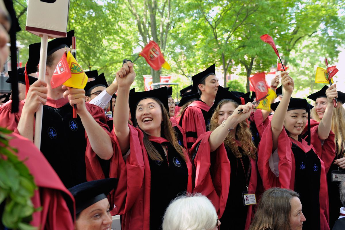 Harvard graduates celebrate at commencement in 2013.