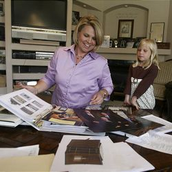 Amy Bailey and her 5-year-old daughter,  Jenna, sort items to put in a time capsule for the Oquirrh Mountain Temple at their home in West Jordan on   Monday.
