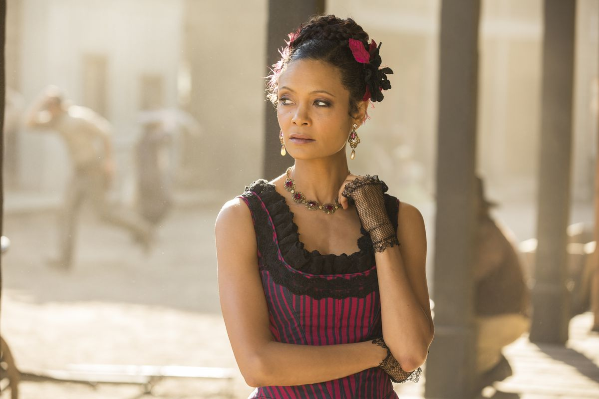 Thandie Newton as Maeve in Westworld looks out on the street.