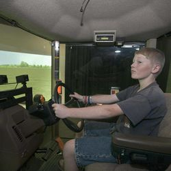 In this Aug. 27, 2012 photo, Mark Gregoricka, 12, operates a tractor simulator in Coralville, Iowa. Scientists at the National Advanced Driving Simulator at the University of Iowa in Coralville this month started what they hope will be a pioneering years long research project that aims to learn how cognitive development affects youth driving performance in tractors.