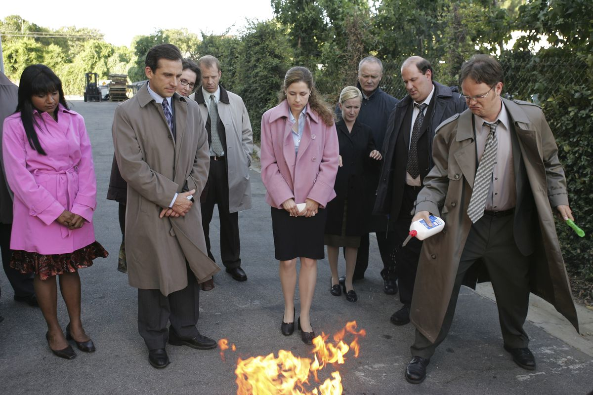 the cast of the office burns a pile of paper in the parking lot