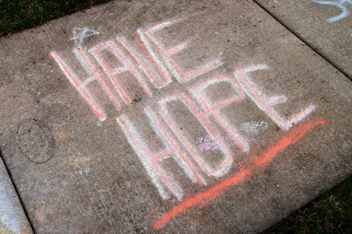 """""""Have Hope"""" is the message for all written in rain-faded chalk on the sidewalk outside a Westchester home in the 10000 block of Drury Lane."""