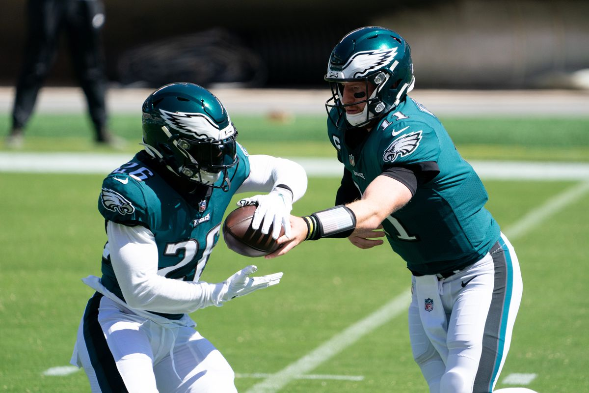 Philadelphia Eagles quarterback Carson Wentz hands off to running back Miles Sanders during the first quarter against the Los Angeles Rams at Lincoln Financial Field.