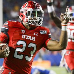 Utah defensive back Julian Blackmon (23) celebrates after returning a pick-up six during the second half of Utah-BYU's play at Laurel Edwards Stadium in Provo on Thursday, August 29, 2019.