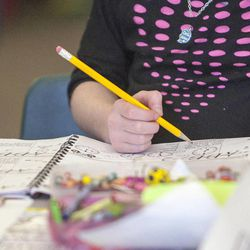 Students in Stacey Johnsen's second-grade class at Daybreak Elementary School work on worksheets Monday, Feb. 25, 2013. HB318, sponsored by Rep. Becky Edwards, R-North Salt Lake, would set class-size caps at 20 students for kindergarten, 22 for first and second grades, and 24 for the third grade.