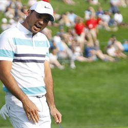 Jason Day reacts after missing his birdie putt on the 18th hole in the 2019 Travelers Championship Third Round at the TPC River Highlands in Cromwell, CT on June 22, 2019.