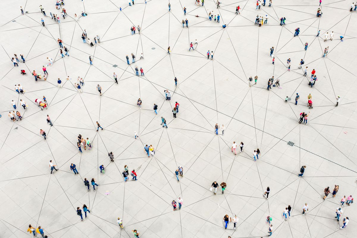 An illustration showing tiny people among a grid of randomly intersecting lines.