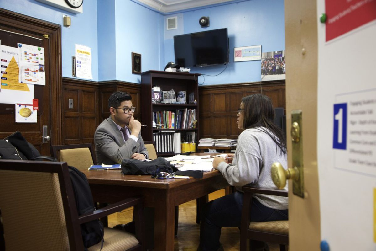 Principal Carl Manalo's small high school in Queens enrolled more than 100 new Central American immigrants.