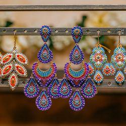 "<b>Miguel Ases</b> Azur beaded earrings (center), <a href=""http://www.fragments.com/azur-beaded-earrings.html?___store=default"">$550</a>."
