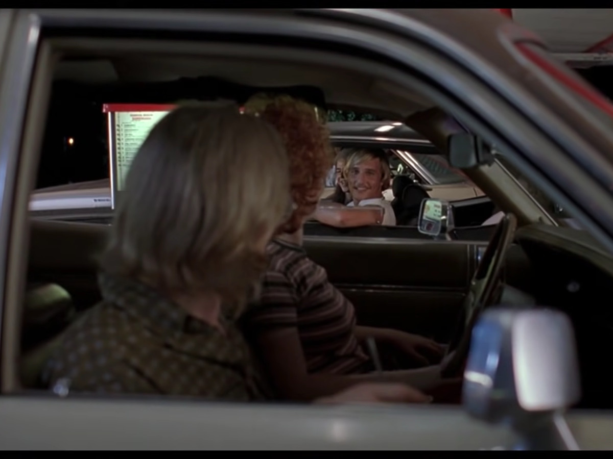 Davis Wooderson (Matthew McConaughey) invites people to a party in the Top Notch drive-thru