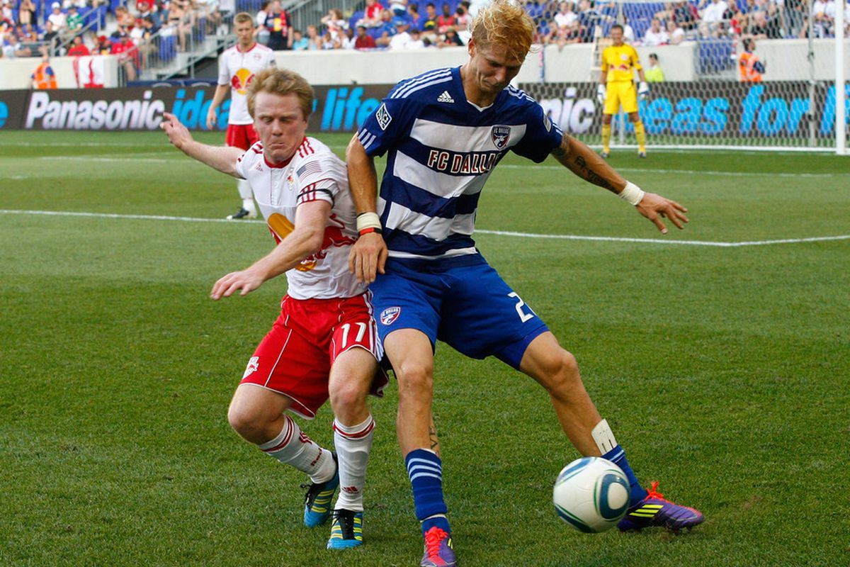 HARRISON, NJ - JULY 23: Brek Shea #20 of FC Dallas and Dax McCarty #11 of the New York Red Bulls battle for a loose ball during the game at Red Bull Arena on July 23, 2011 in Harrison, New Jersey.  (Photo by Andy Marlin/Getty Images)