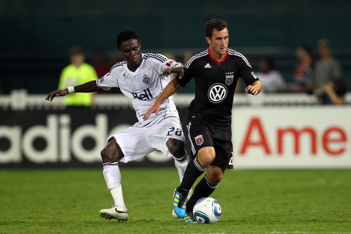 WASHINGTON, DC - AUGUST 13: Stephen King #20 of D.C. United controls the ball against Gershon Koffie #28 of Vancouver Whitecaps FC at RFK Stadium on August 13, 2011 in Washington, DC. (Photo by Ned Dishman/Getty Images)
