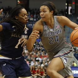 UConn's Napheesa Collier (24) drives past Notre Dame's Lili Thompson (1) during the Notre Dame Fighting Irish vs UConn Huskies women's college basketball game in the Women's Jimmy V Classic at the XL Center in Hartford, CT on December 3, 2017.