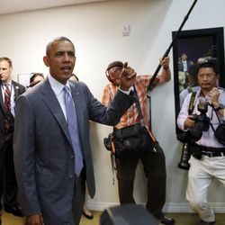 """President Barack Obama chants """"I believe we will win"""" as he drops by to watch the U.S. vs. Belgium World Cup soccer game with White House staff members at the Eisenhower Executive Office Building on the White House grounds in Washington, Tuesday, July 1, 2014."""