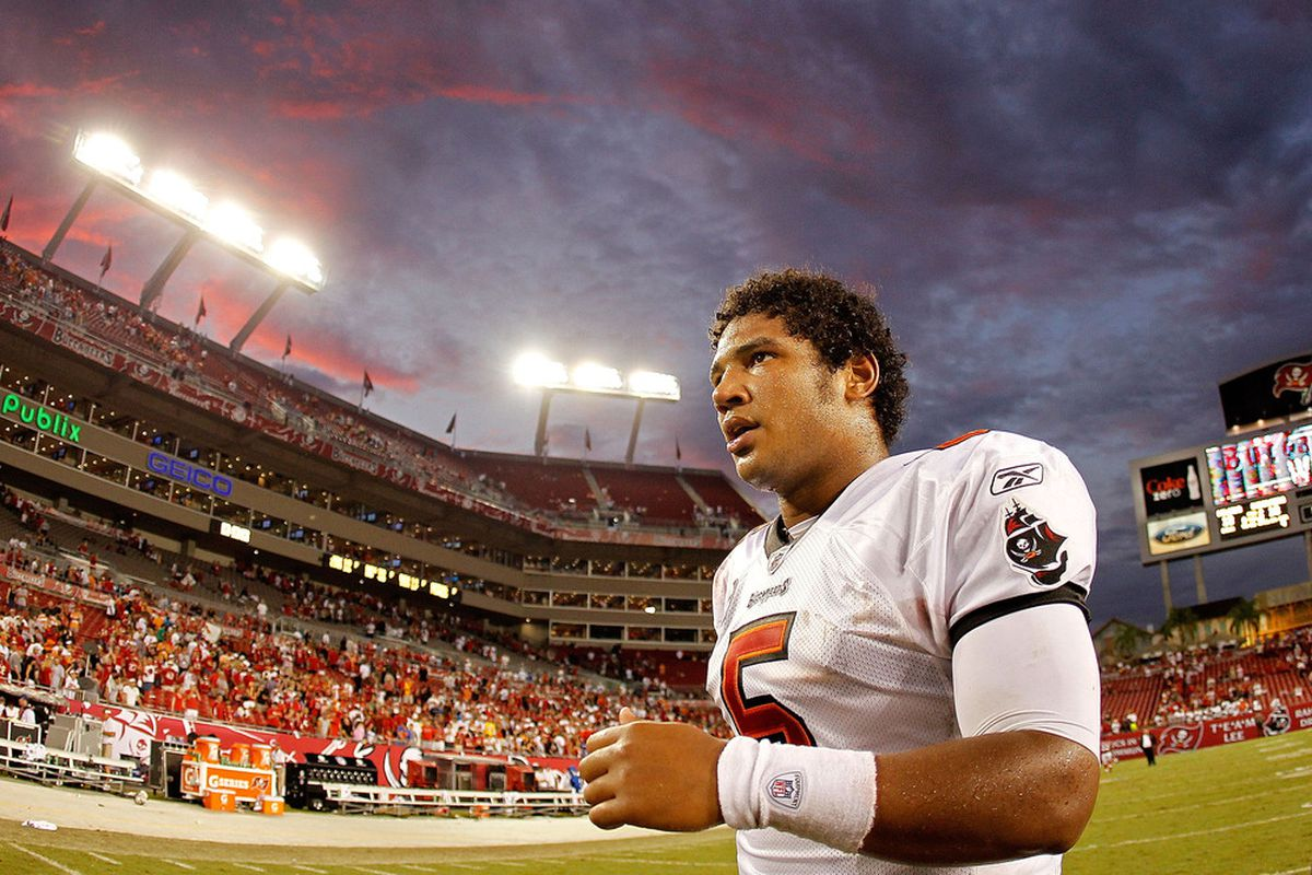 Josh Freeman #5 of the Tampa Bay Buccaneers walks off the field after beating the Atlanta Falcons at Raymond James Stadium on September 25, 2011 in Tampa, Florida.  (Photo by Mike Ehrmann/Getty Images)