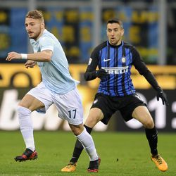 Ciro Immobile of SS Lazio compete for the ball with Matias Vecino of FC Internazionale during the serie A match between FC Internazionale and SS Lazio at Stadio Giuseppe Meazza on December 30, 2017 in Milan, Italy.