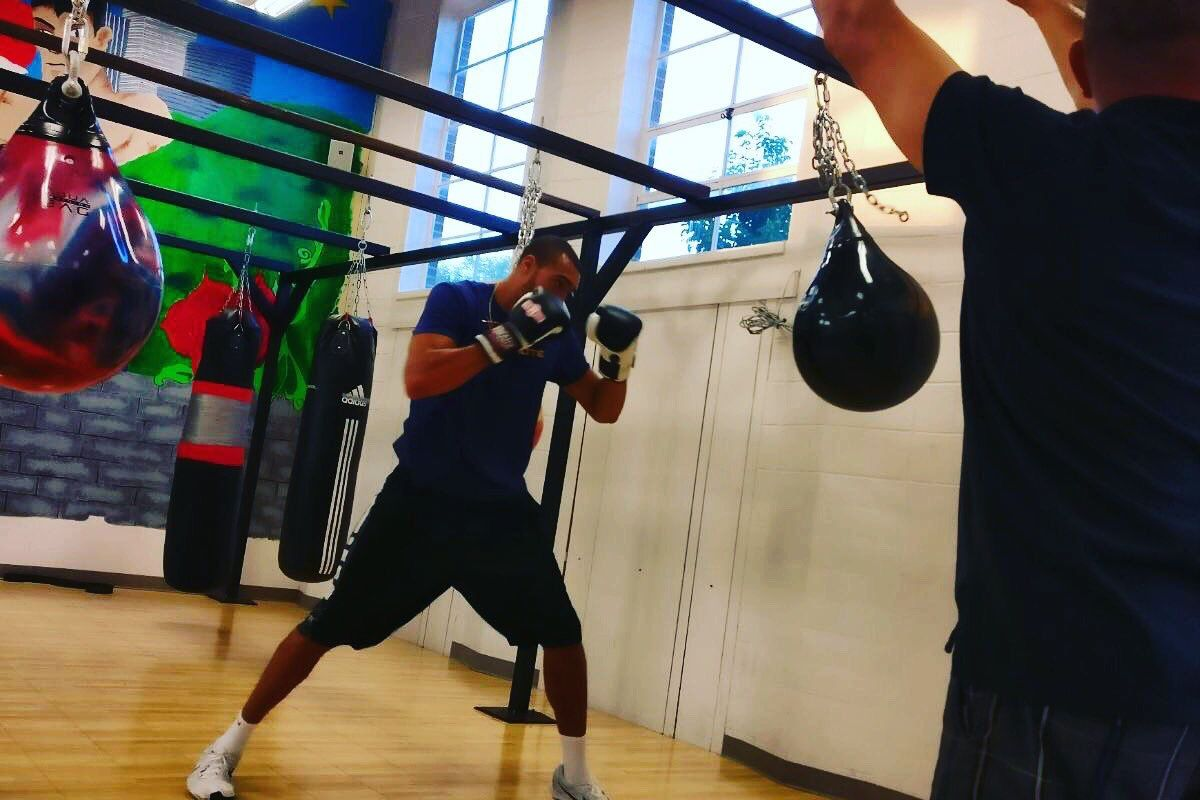 Utah Jazz center Rudy Gobert goes through an off-season boxing routine with trainer Matt Pena watching from the side.