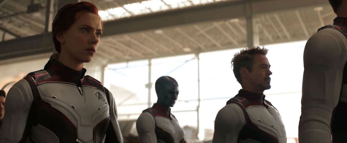 black widow, nebula, and tony stark walk in their time travel suits in avengers: endgame