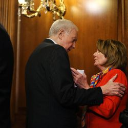 Sen. Orrin Hatch, R-Utah, president pro tem of the U.S. Senate and member and former chairman of the Senate Judiciary Committee, confers with House Democratic Leader Nancy Pelosi, D-Calif., after a bipartisan, bicameral enrollment ceremony for the Every Student Succeeds Act (S. 1177) at the U.S. Capitol in Washington, D.C., on Wednesday, Dec. 9, 2015.