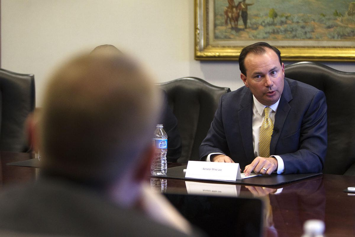 FILE - Sen. Mike Lee, R-Utah, meets with reporters and members of the editorial board at the Deseret News in Salt Lake City, Monday, Aug. 29, 2016. The Healthier Utah Coalition's member organizations are disheartened by what they believe is the U.S. Senat