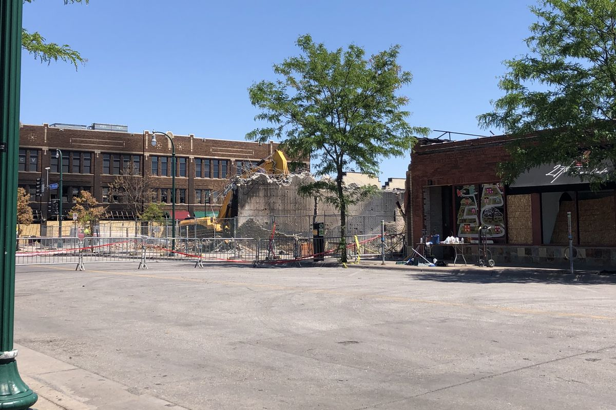 The street where the restaurant once was. A pile of rubble is being removed by a construction crew.