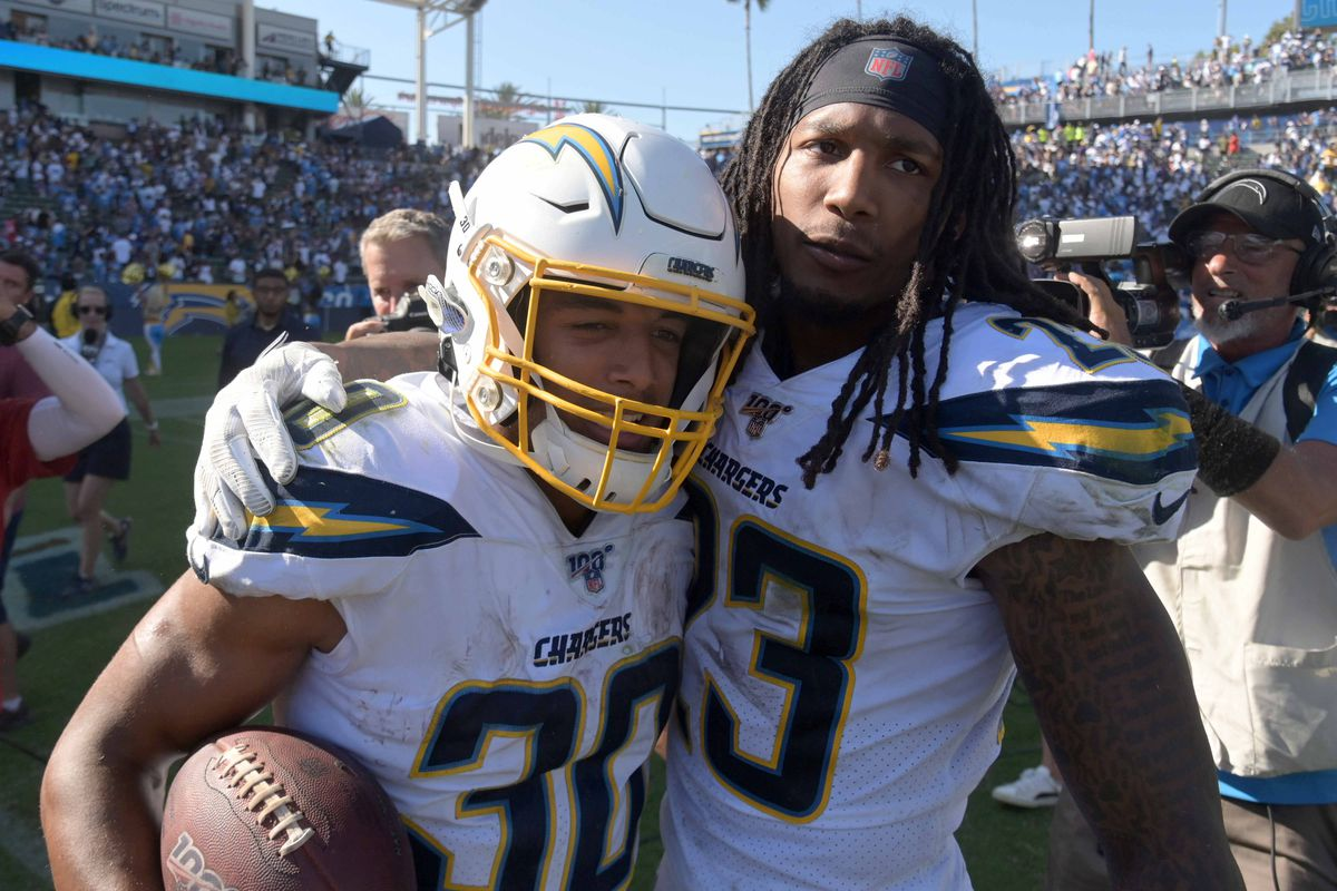 Los Angeles Chargers running back Austin Ekeler celebrates with defensive back Rayshawn Jenkins after scoring on a 7-yard touchdown run in overtime against the Indianapolis Colts at Dignity Health Sports Park.