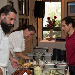 Sommelier Larry Stone looks on as Koren Grieveson and Stephen Dunne prep dishes