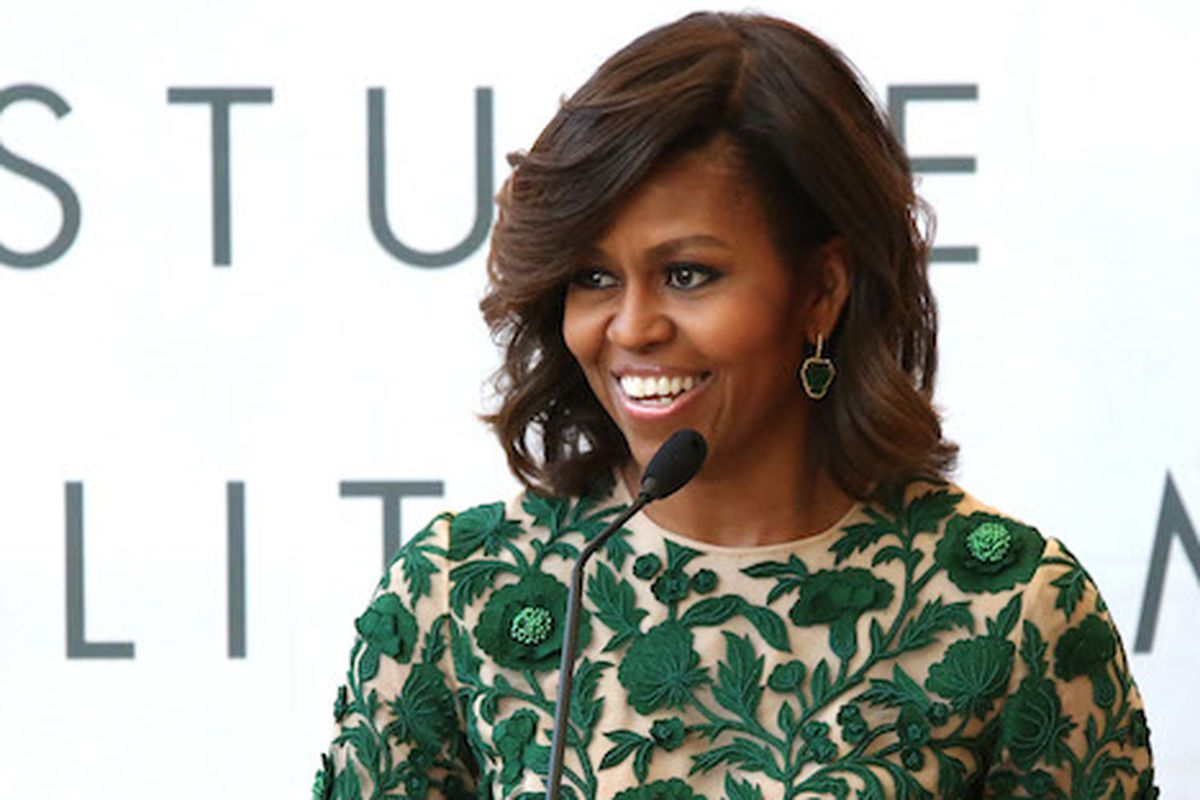 The FLOTUS speaking at the opening of the Anna Wintour Costume Center. Image via Getty.