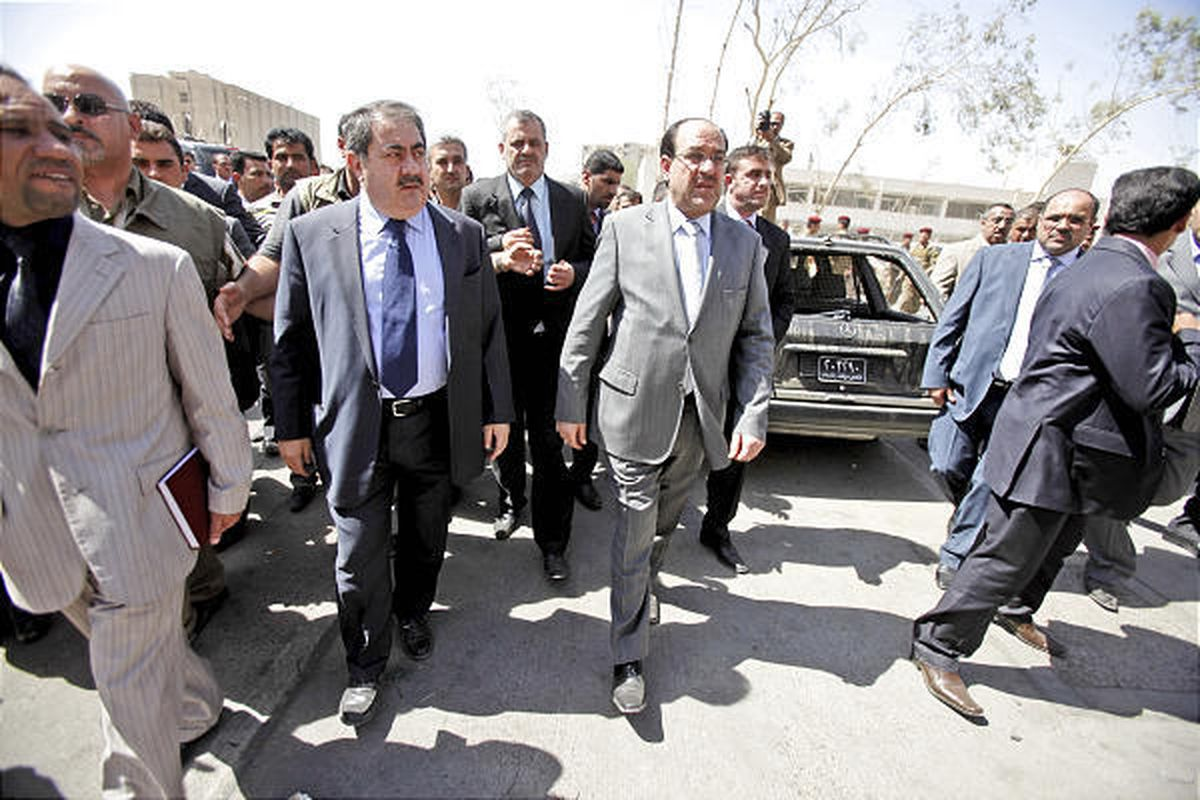 Iraqi Prime Minister Nouri al-Maliki, center, surveys damage to the foreign ministry building, five days after a bombing in Baghdad Monday.