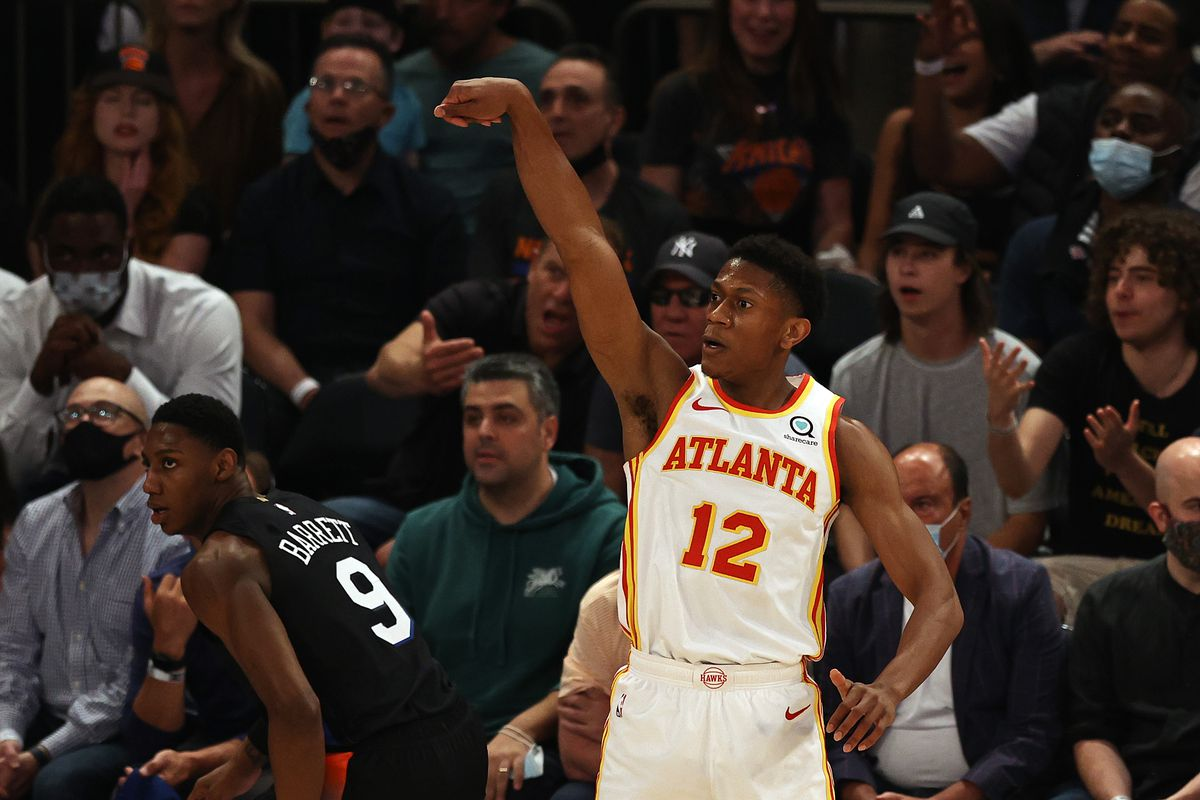 De'Andre Hunter of the Atlanta Hawks celebrates his three point shot in the first quarter against the New York Knicks during game two of the Eastern Conference Quarterfinals at Madison Square Garden on May 26, 2021 in New York City.
