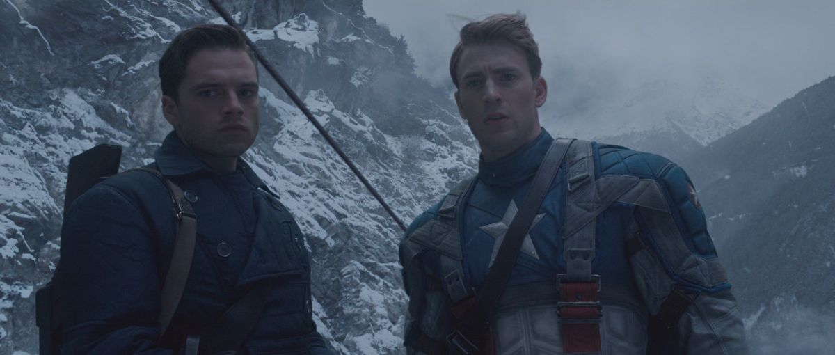bucky and captain america stand on a snow covered mountain in captain america the first avenger